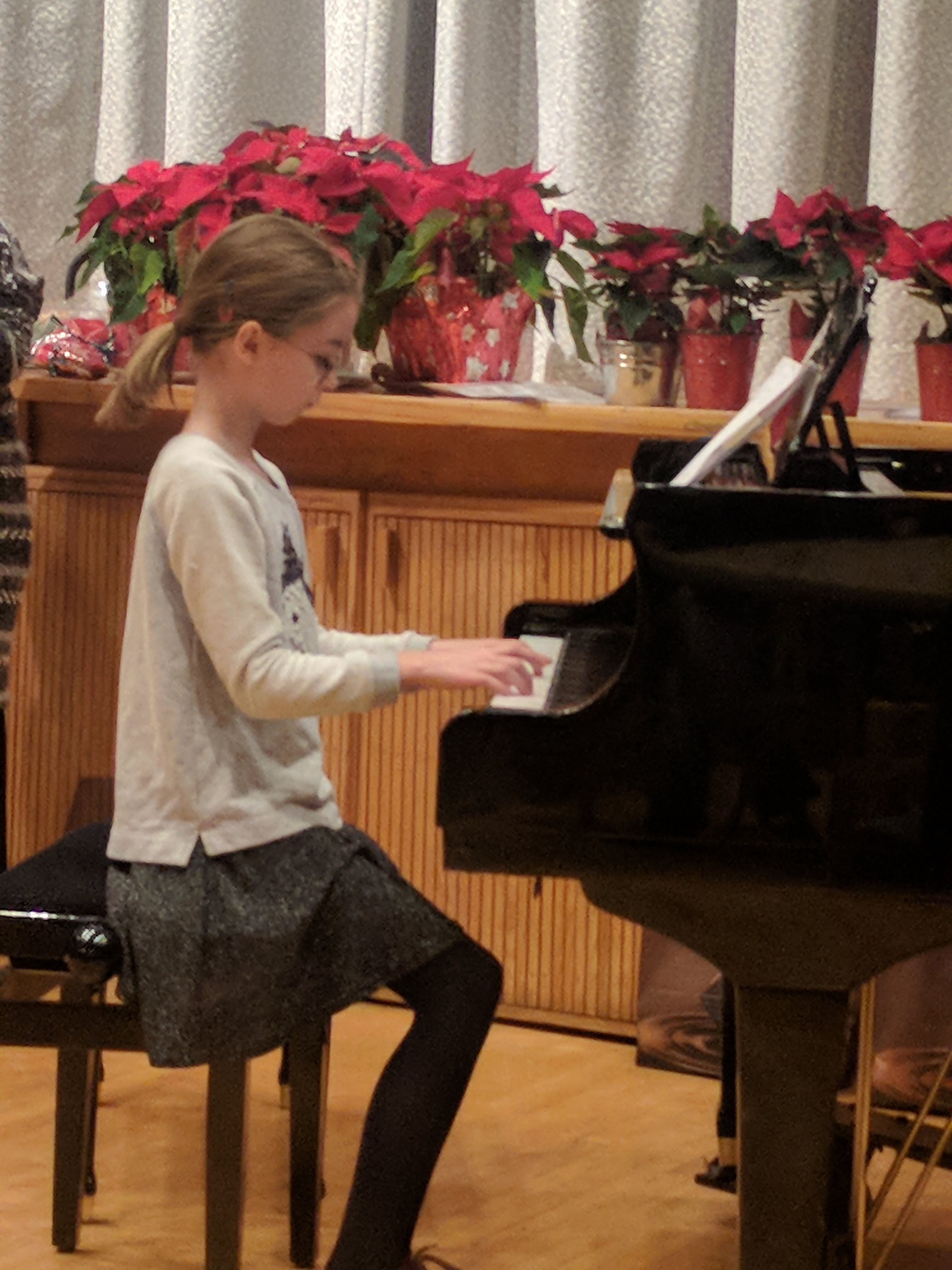 Young girl showing her piano skills